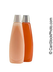 Shampoo and Conditioner in Bottles - Two bottles of shampoo...