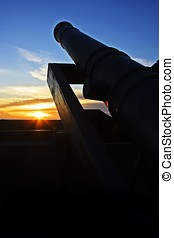 Artillery - An historical artillery in the sunset scene.