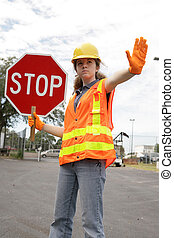Road Crew Stop Sign - A female construction worker stopping...