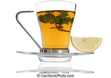 Fresh Tea - Tea with lemon slice and herbs on...