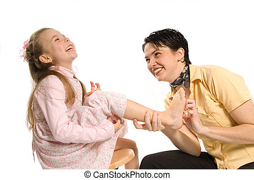 tickle - mom tickling daughter on white background laughing