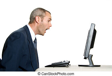 Surprised - surprised man in blue suit in front of computer