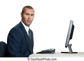 Huh - surprised man in blue suit in front of computer