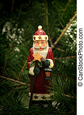 Santa Claus  on a  background of conifer