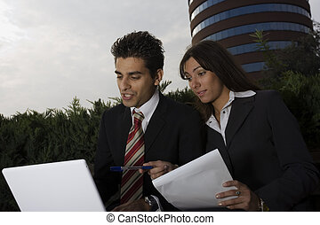 business couple - two colleagues working together on a...