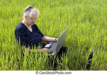 women in grass with