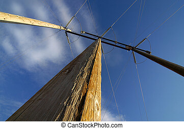 Power Lines - View of powerlines from below with blue sky...