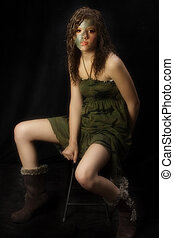 Camo Teen - Beautiful teen girl in camo dress over black...