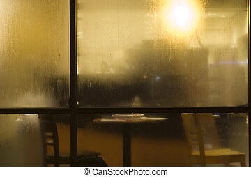 Cafe Behind Dew Covered Glass - a view of cafe blurred by...