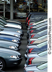 Dealer\\\'s shop - Two rows of car stacked at a locak car...