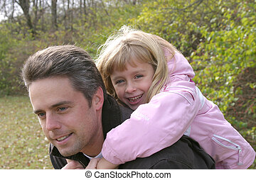 Daddy\\\'s Little Girl - blonde girl and father smiling and...