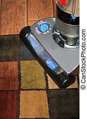 Steam Clean Rug - Steam cleaning a rug on a laminate floor