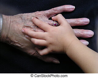 Great Grandmas Hands - A three year old child clutches her...