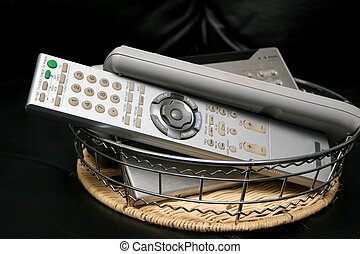 pile of remotes - basket full of defunct remote controls for...