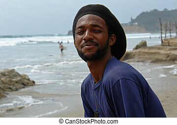 happy rasta-man on the beach of pacific ocean. ecuador....