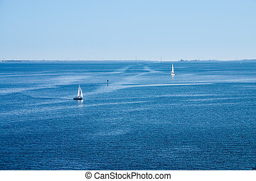 Waterscape - Calm waterscape with sailboats and patterns...