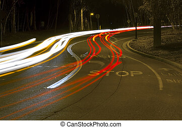 Traffic Curve - A long exposure of traffic winding through a...