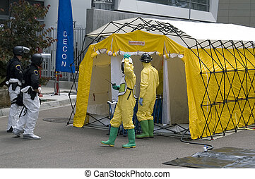 Hazmat - Hazmat crew members and a SWAT policemen awaiting a...