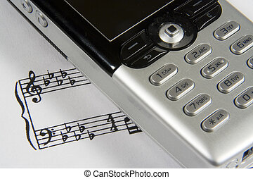 Ringtone II - A closeup of a cellular phone over a...