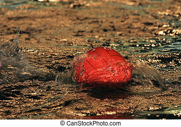 Red ball - The image of a red ball on water