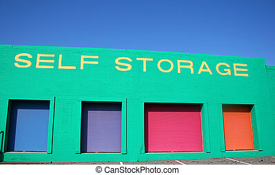 Self Storage - Colorful self storage warehouse with blue sky...