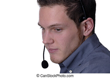 Tech Support - Young Man Wearing A Telephone Headset Giving...