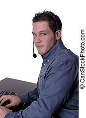 Tele Sales - A Handsome Young Man Working In A Call Center,...