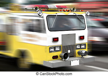Fire Engine - yellow fire engine in speed motion...