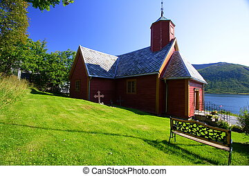 red wood church in the Senja island Norway
