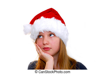 Chrismas girl - Portrait of a young girl wearing Santas hat...