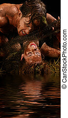 Mud Couple - Attractive young couple covered in mud and...