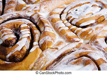 yummy rolls - close up of cinnamon rolls fresh out of the...