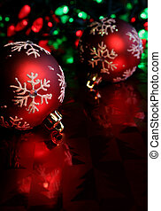 Red Snowflake Bauble - Two red christmas baubles illuminated...