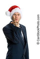 Merry X-mas - man inblue suit blowing kiss on white...