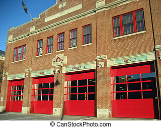 Fire Station - historic brick fire station with bright red...