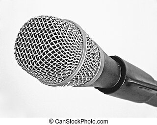 Microphone - Close-up of a microphone over white background