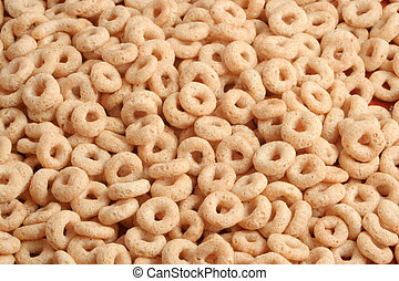oat cereal - a closeup of toasted golden oats cereal