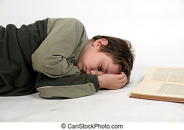 sleepy reader - a child falls asleep while reading a book
