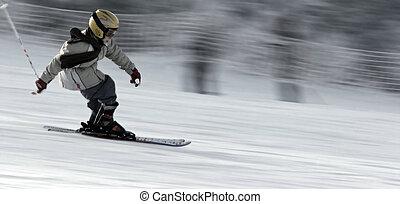 Little skier - Young boy wearing helmet speeding on the skis