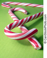 Candy Canes - Extreme closeup of candy canes on green...