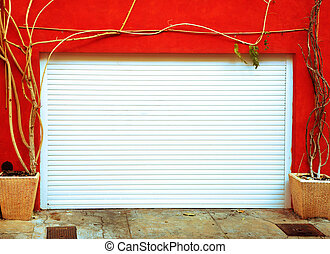 Bright orange wall with a white garage door - Metal garage...