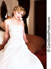 Blond bride with red lips - Young blond bride with short...