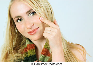 Blond girl in a scarf - Young girl with green eyes and long...