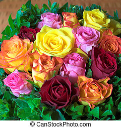 Party roses arranged in variety of color - Red, orange, pink...