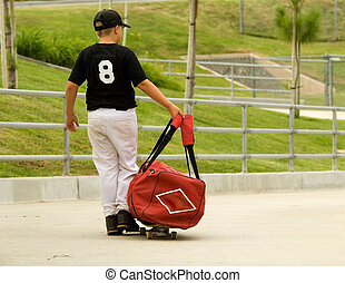 Going to baseball practice - Little boy in baseball uniform...
