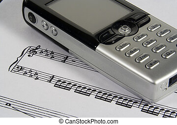 Ringtone I - A closeup of a cellular phone over a sheetmusic