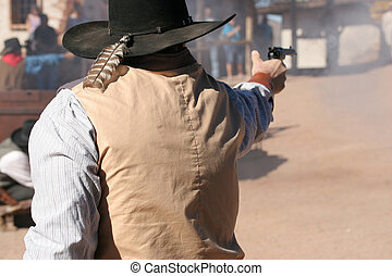 Exchange of Gunfire - Cowboy shooting the gun; wild west