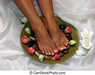 Just Relax - A pair of tanned feet in a spa