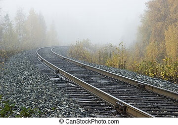 Road into nowhere - Railroad track into fog