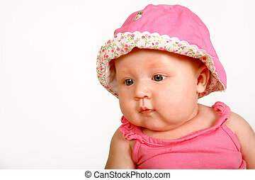 Baby Face - A baby girl sitting with a hat on her head